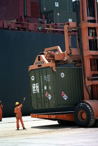 Dockworker and cargo containers
