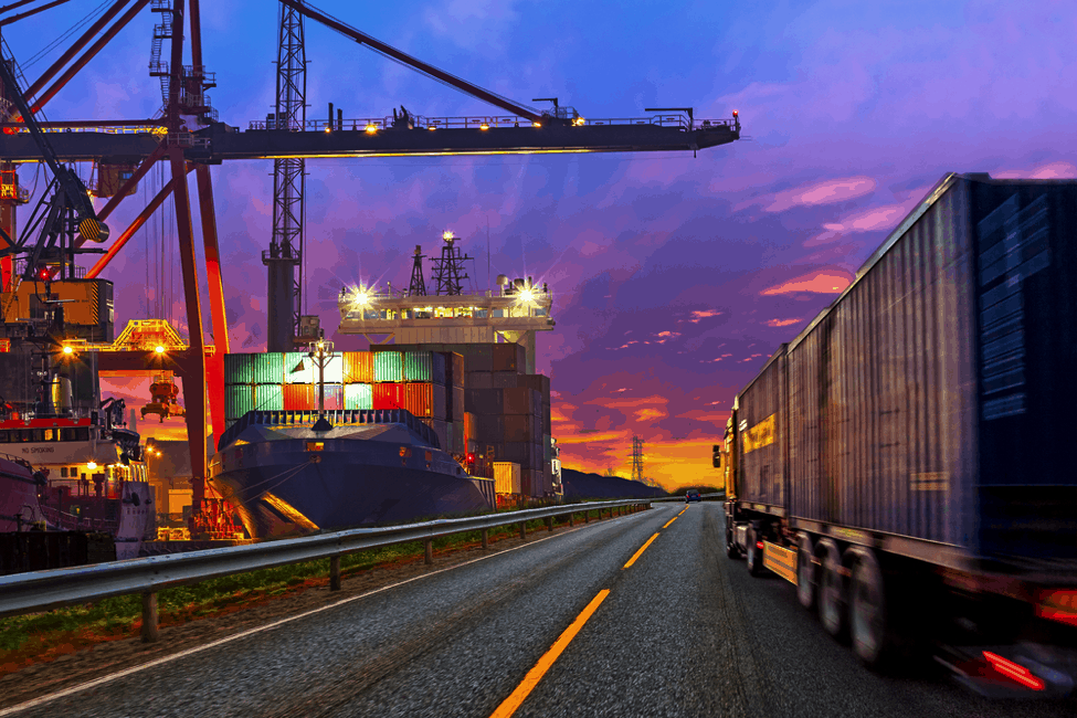 Container Ship at Dock Truck on Road.png
