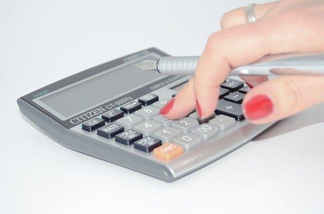 Woman using calculator.
