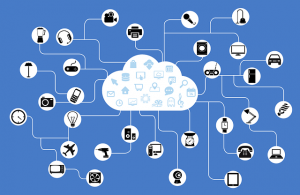 Icons of various technologies connected to a cloud, representing how the Internet of Things is revolutionizing the supply chain.